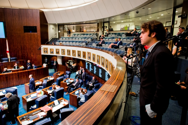 New College student Dylan Pryor watches the Florida Senate in Session in Tallahassee. Pryor and other students spent the Spring semester in the state Capitol.